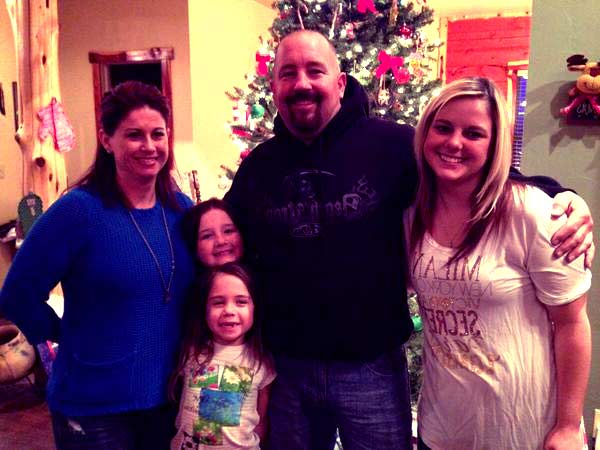 Image of Chuck Seitsinger with his wife and with their kids